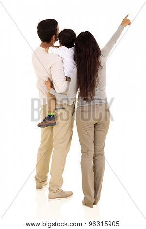 rear view of indian family pointing empty space isolated on white background