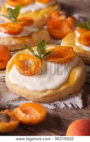 Apricot Puff Pastry With Cream Close-up. Vertical