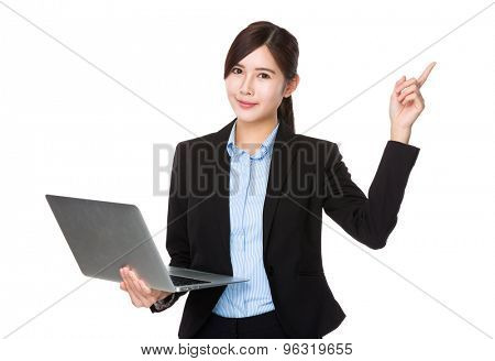 Asian businesswoman use of notebook computer and finger point up