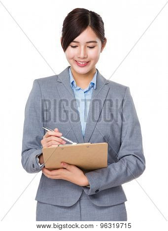 Asain businesswoman take note on clipboard