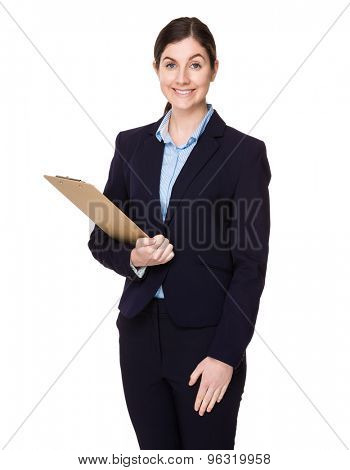 Brunette businesswoman hold with clipboard