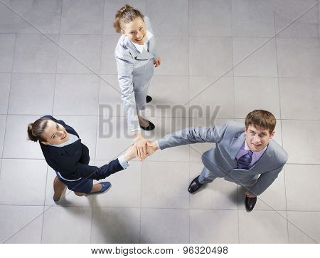 Top view of business people uniting hands in pile