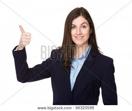 Brunette businesswoman with thumb up