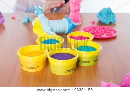 pieces of plasticine on wood background