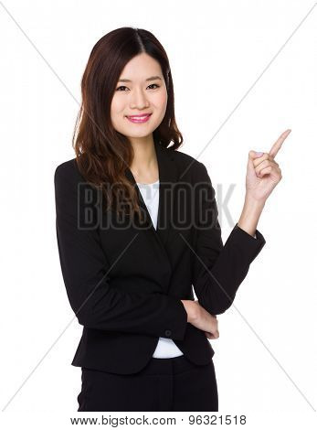 Beautiful businesswoman with finger point up