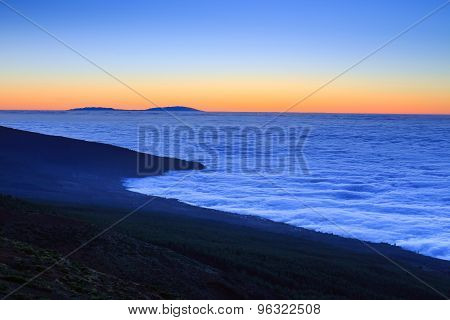 Aerial View Over Clouds Above Ocean Water With Last Sunshine, Tenerife, Canary Islands, Spain