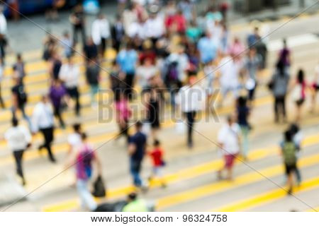 Busy city people on zebra crossing street in Hong Kong