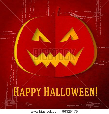 Scary halloween pumpkin with red eyes and smile cut out from craft paper. vector