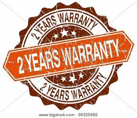 2 Years Warranty Orange Round Grunge Stamp On White