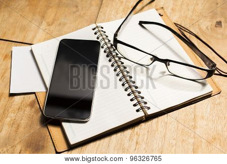 Blank Cell Phone Diary And Glasses