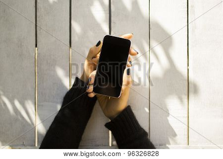 Blank Cell Phone On A Wooden Planks Background