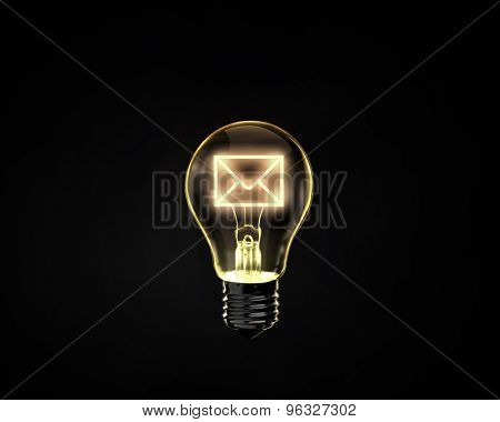 Light bulb with mail sign on dark background