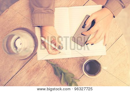 Girl Writes In Notebook, Vintage Photo Effect