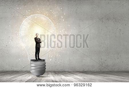 Man holding luminous idea inside light bulb