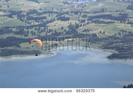 Paraglider Flying Over Bavarian Lake