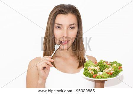 Woman eating healthy food, Caesar salad