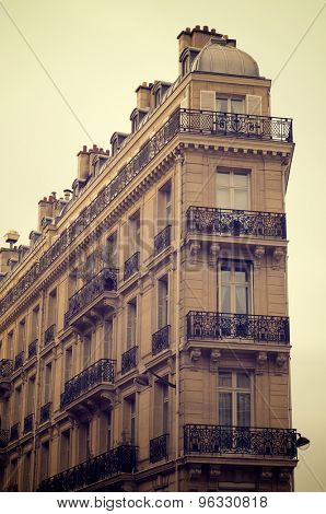 View of the facade of a typical building in the Rue Lafayette, Paris, France.