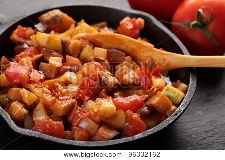 Ratatouille in an iron pan on a rustic table