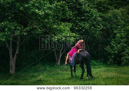 Beautiful woman on a horse