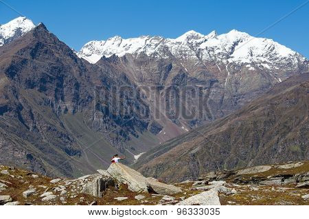 tourists photographed on a background of snowy mountains on the Rohtang Pass which is on the road Ma