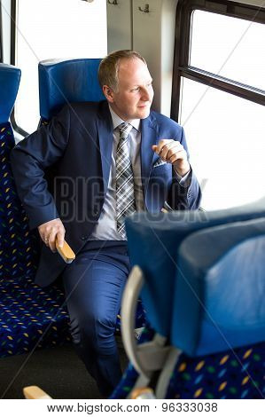 Serious Businessman Sitting In A Train