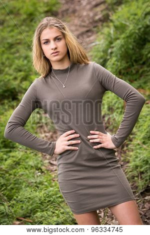 Beautiful teenage fashion model posing outside