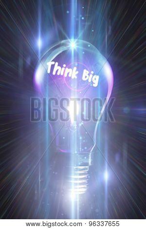 think big against glowing light bulb