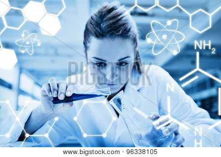 Science graphic against beautiful serious scientist pouring liquid