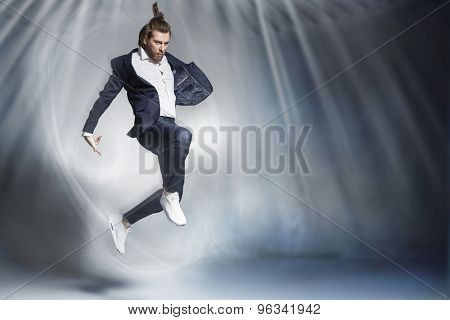 Portrait of  handsome stylish man jumping