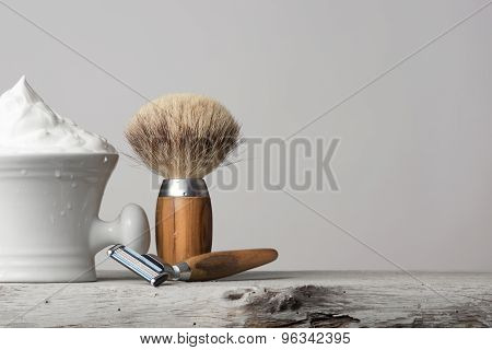 Vintage Shaving Equipment On White Table And Bright Background