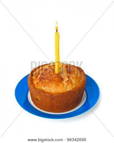 Cake and burning candle isolated on white background