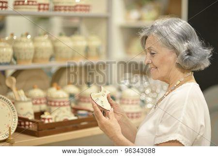 senior woman at souvenir store