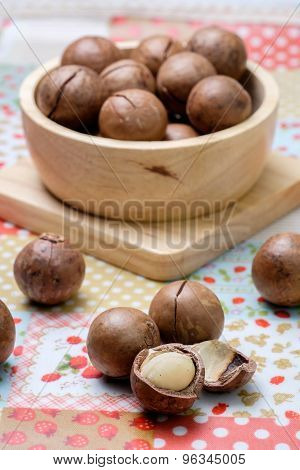 Macadamia On Napery And Wooden Bowl