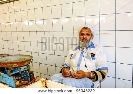 Salesman Counting Money In Dubai Fish Market In Deira, United Emirates