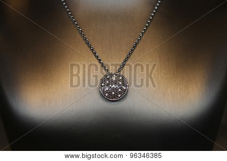 necklace shot against a black background
