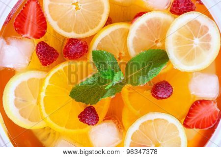 Fruity punch in glass bowl, top view