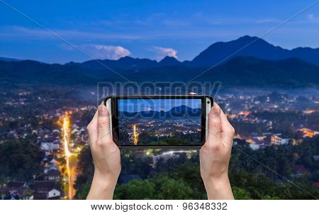Hand Taking Photo At Viewpoint And Landscape In Luang Prabang , Laos.