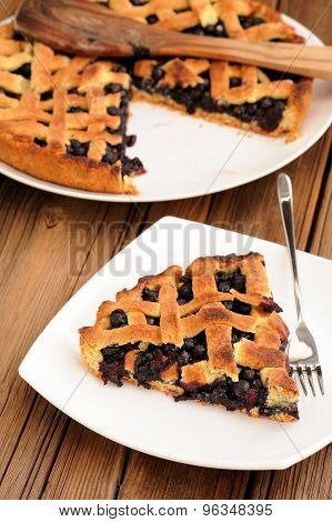 Homemade Lattice Pie With Whole Wild Blueberries Cut In Piece In White Plate With Fork