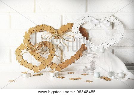 Puzzle made hearts shape on light background