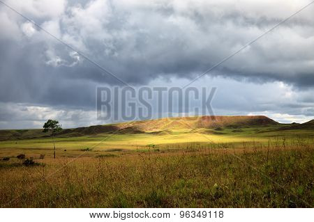 Stunning View To Savanna Under Stormy Cloudy Sky With Single Bright Patch Of Sunlight