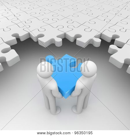 Two persons holding blue puzzle surrounded by white puzzles