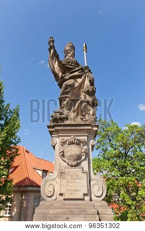 Statue Of St. Augustine On Charles Bridge In Prague