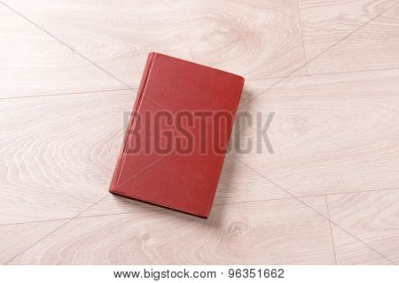 Old book on wooden background