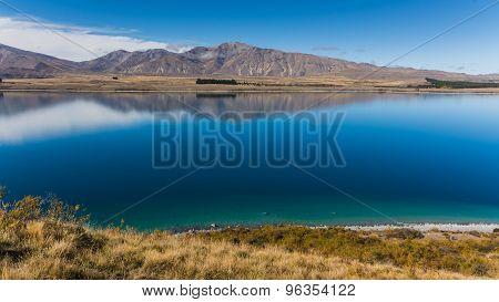 Incredibly Blue Water Of Lake Tekapo, New Zealand