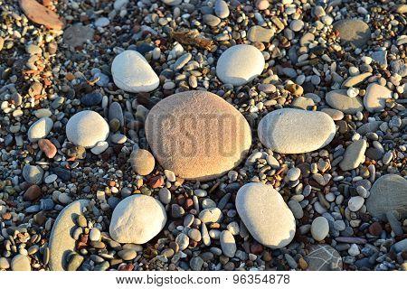 Stone Sun On The Beach Sea