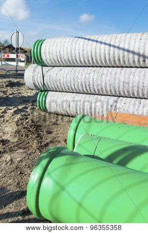 drainpipes in several sizes at a construction site