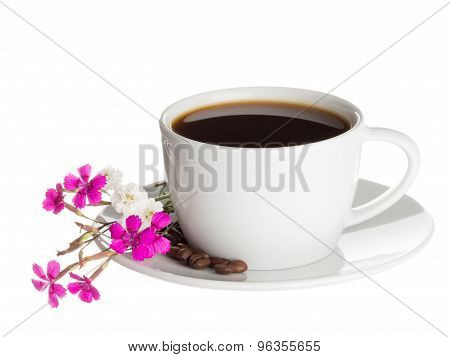 Coffee Cup And Wild Carnation Flowers