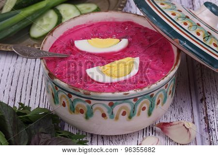 Beetroot Soup - Cold Soup With A Beet And Egg Submitted With Parsley, A Basil And A Fresh Cucumber