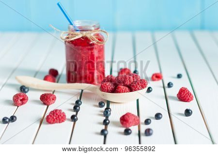Jar of fruity jam on white background. Preserved fruits
