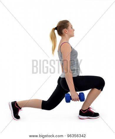 Girl exercise thighs muscles with dumbbells on white background